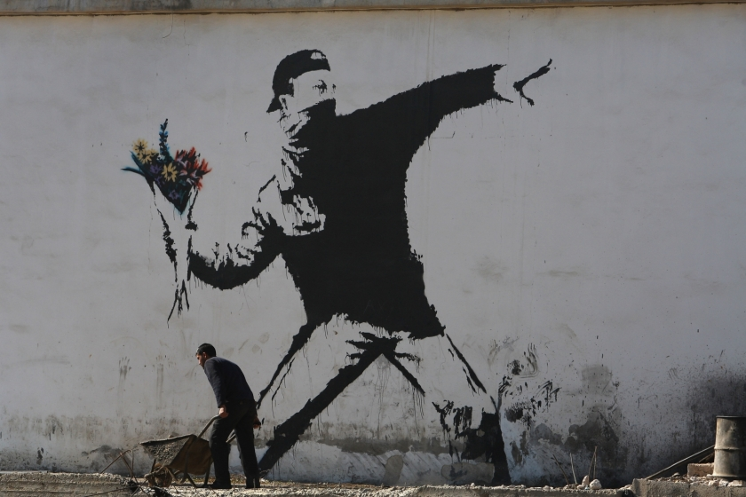 Banksy wall, courtesy IB Times